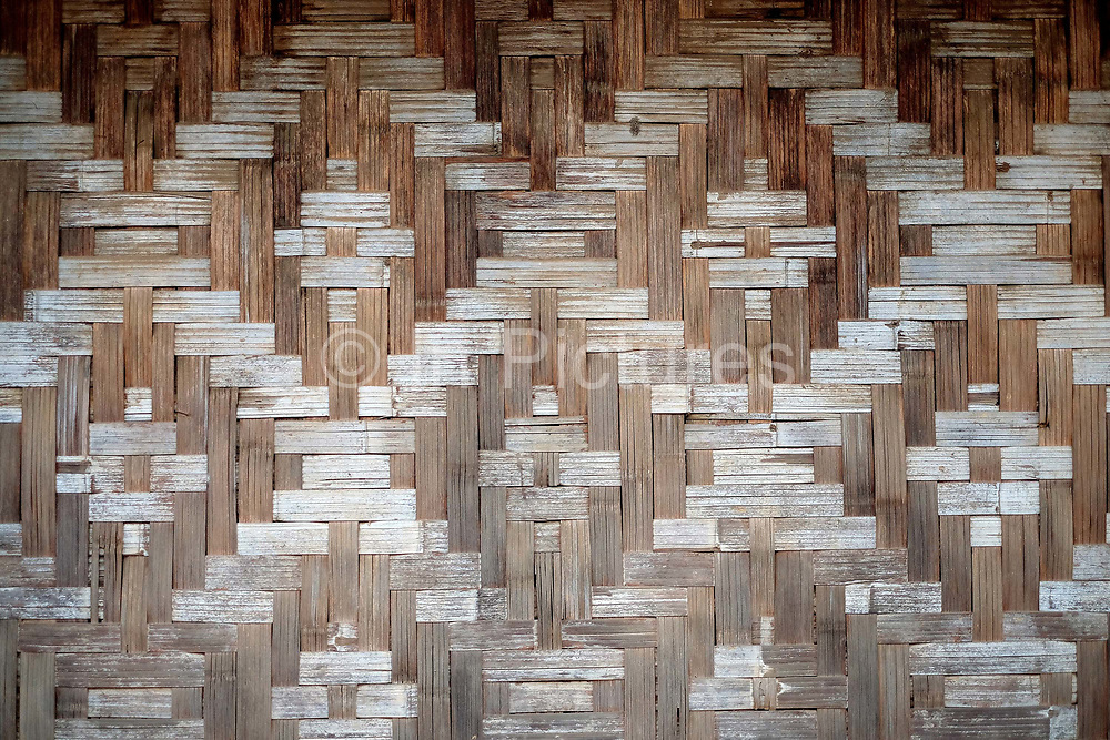 A close-up of the bamboo wall of a traditonal house in a Khi village on 20th January 2016 in Kayah State, Myanmar