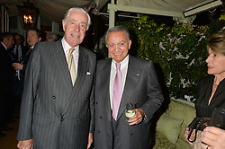 Left to right, RUPERT HAMBRO and WAFIC SAID at a party to celebrate the publication of Right or Wrong: The Memoirs of Lord Bell held at Mark's Club, Charles Street, London on 16th October 2014.
