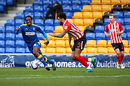 AFC Wimbledon attacker Zach Robinson (14) battles for possession with Sunderland defender Bailey Wright (5) during the EFL Sky Bet League 1 match between AFC Wimbledon and Sunderland at Plough Lane, London, United Kingdom on 16 January 2021.