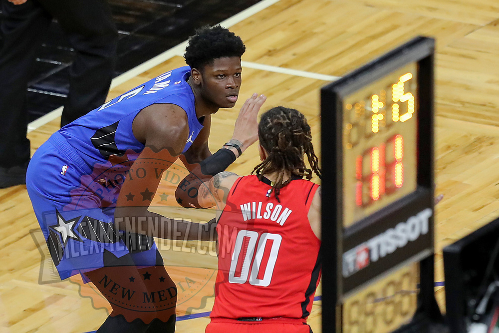 ORLANDO, FL - APRIL 18: Mo Bamba #5 of the Orlando Magic sets up a play as D.J. Wilson #00 of the Houston Rockets defends during the first half at Amway Center on April 18, 2021 in Orlando, Florida. NOTE TO USER: User expressly acknowledges and agrees that, by downloading and or using this photograph, User is consenting to the terms and conditions of the Getty Images License Agreement. (Photo by Alex Menendez/Getty Images)*** Local Caption *** Mo Bamba;  D.J. Wilson