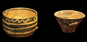 Pottery cup with white painted decoration and four raised bosses Minoan, 1950-1850 BC . From the Isthmus of Ierapetra.
