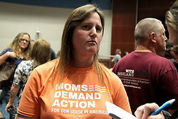 March 27, 2019 - Coral Springs, USA - Heather Chapman, a Parkland parent, attended the Mental Health and Suicide Prevention Town Hall Meeting hosted by the city of Coral Springs on March 27, 2019. The emergency town hall was convened after two Marjory Stoneman Douglas students - a current one, and an alumnus - died by suicide in the past 10 days. (Credit Image: © Miami Herald/TNS via ZUMA Wire)