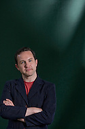 Scottish writer Alan Bissett, pictured at the Edinburgh International Book Festival where he talked about his latest book entitled 'Pack Men'. The three-week event is the world's biggest literary festival and is held during the annual Edinburgh Festival. The 2011 event featured talks and presentations by more than 500 authors from around the world..