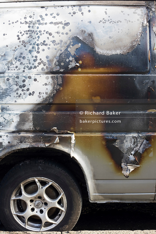 Scorched paintwork of a van after an inner-city estate fire in south London. About 310 people were forced to leave their homes after the fire engulfed a wooden structure under construction in scaffolding at Sumner Road and Garrisbrooke Estate, Peckham, London at about 0430 AM. It spread to two blocks of maisonettes and a destroyed a pub. More than 150 firefighters tackled this unusually large and ferocious fire which injured ten people, including two police officers who received hospital treatment for minor injuries.  .