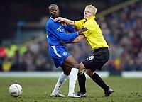 Photograph: Scott Heavey.<br /> Watford v Chelsea. FA Cup Third Round. 03/01/2004.<br /> Heider Helguson (R) and William Gallas collide