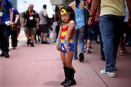 Lea Kim displays a Superwoman costume at Comic-Con at the San Diego Convention Center in San Diego, CA on Thursday, July 12, 2012.  Comic-Con is the World's largeet comic convention which feature booths movie premieres, workshops and celebrity appearances and much more.
