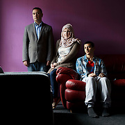 Mona Hussain at her home in Barrowfield , Glasgow. With her husband Mahmoud and son Mohammud.  Picture Robert Perry for The Herald and Times. 7th Aug 2015<br /> <br /> Must credit photo to Robert Perry<br /> FEE PAYABLE FOR REPRO USE<br /> FEE PAYABLE FOR ALL INTERNET USE<br /> www.robertperry.co.uk<br /> NB -This image is not to be distributed without the prior consent of the copyright holder.<br /> in using this image you agree to abide by terms and conditions as stated in this caption.<br /> All monies payable to Robert Perry<br /> <br /> (PLEASE DO NOT REMOVE THIS CAPTION)<br /> This image is intended for Editorial use (e.g. news). Any commercial or promotional use requires additional clearance. <br /> Copyright 2014 All rights protected.<br /> first use only<br /> contact details<br /> Robert Perry     <br /> 07702 631 477<br /> robertperryphotos@gmail.com<br /> no internet usage without prior consent.         <br /> Robert Perry reserves the right to pursue unauthorised use of this image . If you violate my intellectual property you may be liable for  damages, loss of income, and profits you derive from the use of this image.