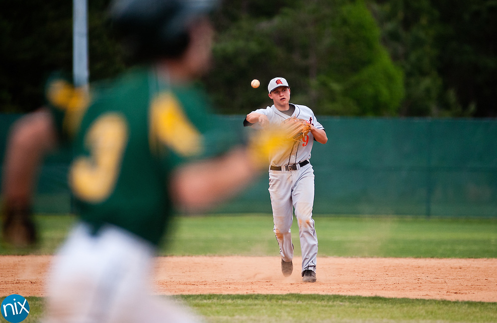 Northwest Cabarrus' Corey Seager throws a runner out Thursday afternoon at Central Cabarrus High School. Central was leading 3-2 when the game was suspended due to weather in the fourth inning. (photo by James Nix)