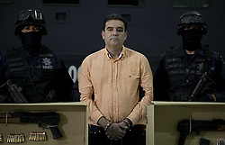 MEXICO CITY, Nov. 9, 2010  Mexican federal police present Manuel Fernandez Valencia (C), an alleged collaborator of the drug cartel leader Joaquin Guzman Loera, alias ''El Chapo Guzman'', at the federal police headquarters, in Mexico City, capital of Mexico, on Nov. 8, 2010. Valencia was one of the main introducers of drugs to the United States, according to Mexican Federal authorities. (Xinhua/Jorge Dan Lopez) (Credit Image: © Xinhua/ZUMApress.com)