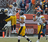 Pittsburgh's James Farrior, right, and the Steelers celebrate a fumble recovery yesterday against the Browns. Charlie Frye lost the ball while being sacked in the third quarter.