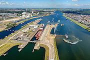 Nederland, Noord-Holland, IJmuiden, 01-08-2016; sluiscomplex IJmuiden met Noordersluis. Parallel aan en rechts van de Noordersluis wordt een nieuwe grote zeesluis gebouwd. Amsterdam aan de horizon.<br /> Lock complex IJmuiden, parallel to the large Northern Lock a new large sea lock will be build.<br /> <br /> luchtfoto (toeslag op standard tarieven);<br /> aerial photo (additional fee required);<br /> copyright foto/photo Siebe Swart