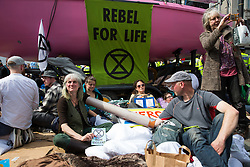 London, UK. 18th April 2019. Climate change campaigners from Extinction Rebellion during a large police operation to try to clear Oxford Circus of protesters on the fourth day of International Rebellion activities to call on the British government to take urgent action to combat climate change.