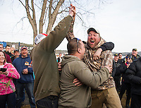 Josh Philbrick reacts as his name is drawn for the grand prize of $15,000 for his 4.26 lb Rainbow Trout caught Saturday morning in Alton Bay during the awards ceremony held on Sunday afternoon at Derby Headquarters in Meredith.  (Karen Bobotas/for the Laconia Daily Sun)