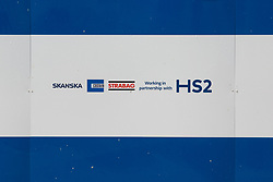 London, UK. 6th August, 2021. SCS signage on boarding around the Euston construction site for the HS2 high-speed rail link. SCS is a HS2 joint venture contractor formed by Skanska, Costain and Strabag.