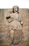 Roman Sebasteion relief sculpture of Ethnos with belted peplos, Aphrodisias Museum, Aphrodisias, Turkey.   Against a white background.<br /> <br /> The matronly figure wears a belted classical dress (peplos) and held her long cloak up behind. The square hole above her shoulder with a corresponding hole in the back, was for lifting the finished relief into the ancient building by crane. .<br /> <br /> If you prefer to buy from our ALAMY STOCK LIBRARY page at https://www.alamy.com/portfolio/paul-williams-funkystock/greco-roman-sculptures.html . Type -    Aphrodisias     - into LOWER SEARCH WITHIN GALLERY box - Refine search by adding a subject, place, background colour, museum etc.<br /> <br /> Visit our ROMAN WORLD PHOTO COLLECTIONS for more photos to download or buy as wall art prints https://funkystock.photoshelter.com/gallery-collection/The-Romans-Art-Artefacts-Antiquities-Historic-Sites-Pictures-Images/C0000r2uLJJo9_s0