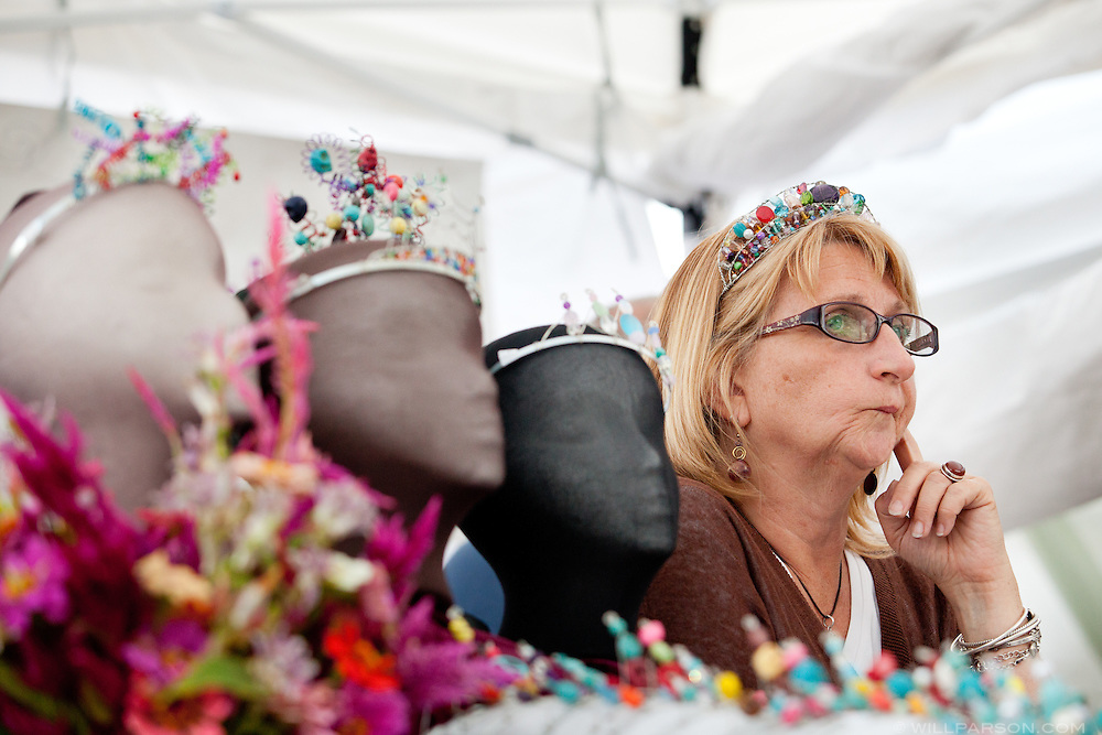 Tina Kelsey, of Shade, Ohio, pauses in thought while talking with a customer during the 13th Annual Paw Paw Festival in Albany, Ohio on Sept. 17, 2011. The three-day festival features music, food, and vendors like Kelsey, owner of Tina's Tiaras in Shade.