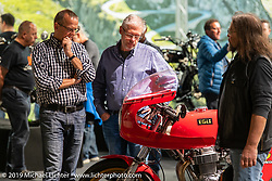 Checking out an Egli Honda on display of antique Swiss manufactured motorcycles in the Swiss-Moto Customizing and Tuning Show. Zurich, Switzerland. Friday, February 22, 2019. Photography ©2019 Michael Lichter.