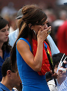 Juliann Ashcraft, widow of Andrew Ashcraft, walks into a prayer vigil ceremony for the 19 firefighters killed in a nearby wildfire, including her husband, in Prescott, Arizona July 2, 2013. REUTERS/Rick Wilking (UNITED STATES)