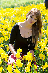 © London News Pictures. 21/04/2013. London, UK. Oshia Pota (Corr) 28, posing with daffodils in the sunshine in Hyde Park, London. Photo credit : Ben Cawthra/LNP