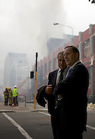 New Zealand Prime Minister John Key in Christchurch City Centre to survey the devastation after a Powerful earth quack ripped through Christchurch, New Zealand on Tuesday lunch time killing at least 65 people as it brought down buildings, buckled roads and damaged churches and the Cities Cathedral. Photo Tim Clayton
