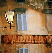 Old sign on the streets of Siena, Tuscany, Italy.