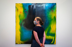 © Licensed to London News Pictures. 16/06/2021. LONDON, UK. A staff member poses with a work by Harminder Judge at a preview of the RA Schools Show 2021, exhibiting the UK's newest artistic talent graduating from the RA Schools at the Royal Academy of Arts until 4 July 2021.  Photo credit: Stephen Chung/LNP