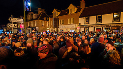 Crowds celebrate Hogmanay at the Biggar Hogmanay bonfire lit at 9.30pm on Hogmanay by local resident John Michie.<br /> <br /> This is probably the biggest new year bonfire anywhere in the UK and continues a tradition going back hundreds of years.<br /> <br /> <br /> (c) Andrew Wilson   Edinburgh Elite media