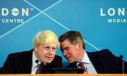 © Licensed to London News Pictures. 28/08/2012. Westminster, UK London Mayor Boris Johnson (L) and Hugh Robertson MP, Minister for Sports and the Olympics  at a Media Briefing on Security and Transport Readiness at The London 2012 Paralympic Games today 28 August 2012. Photo credit : Stephen Simpson/LNP