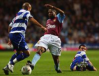 Photo. Daniel Hambury.<br />Carling Cup.<br />22/09/2004.<br />Aston Villa V Queens Park Rangers. <br />Aston Villa's Ulises De La Cruz leaves QPR's Kevin McLeod grounded and beats Richard Edghill to the ball