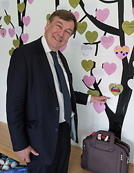 © Licensed to London News Pictures . 17/07/2015 . Manchester , UK . JOHN WHITTINGDALE OBE , MP for Maldon and Secretary of State for Culture Media and Sport , pointing to a photograph of Chancellor George Osborne at a wall of visitors' messages during a visit to the newly extended and refurbished Whitworth Art Gallery , in Manchester . The venue has been  nominated for this year's (2015) Riba Stirling Prize for the UK's best new building . Photo credit: Joel Goodman/LNP