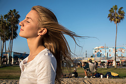 Xenia Viragh walks along the boardwalk  of Venice Beach, California to be seen and watch street performers, October 9, 2014. (Photo by Ami Vitale)