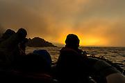 Photographers chasing the light from a Zodiac at Karl XII-island, northeast of Svalbard | Fotografer som jakter på lyset fra en Zodiac ved Karl XII-øyen, nordøst for Svalbard.
