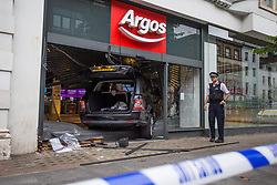 © Licensed to London News Pictures.  30/08/2021. London, UK. Police guard the scene after a Range Rover crashes into Argos in Tottenham Court Road, central London. Photo credit: Marcin Nowak/LNP
