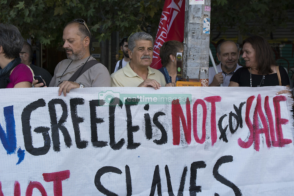 September 7, 2017 - Athens, Greece - Protesters hold banners and shout slogans against the government and Macron's visit. Leftists staged a demonstration to protest over Emmanuel Macron's visit in Athens, along with French businessmen, as they claim their aim is to privatize and buy Greek assets. (Credit Image: © Nikolas Georgiou via ZUMA Wire)