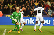 Leicester city goalkeeper Kasper Schmeichel looks on as Swansea city's Wilfried Bony celebrates scoring his teams 2nd goal. Barclays Premier league match, Swansea city v Leicester city at the Liberty stadium in Swansea, South Wales on Saturday 25th October 2014<br /> pic by Andrew Orchard, Andrew Orchard sports photography.