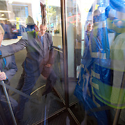 LONDON, ENGLAND - SEPTEMBER 08:  a Security guardstrying to stop protestors from entering the Axa building in the City of London. Protestors targeted buildings of major corporations and banks, on September 8, 2009 in London, England.  (Photo by Marco Secchi/Getty Images)