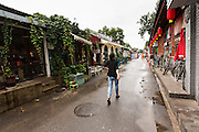 A woman walks through the trendy shopping area in the restored hutong district of Wudaoying  in Beijing, China