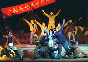 """Actors dance in the play """"We All have a Red Heart"""" in Beijing December 13. The play is being staged in Beijing to mark the 30th anniversary of Mao Zedong's command for a generation of urban youth to move to the countryside and learn proletarian values through farming and labor."""