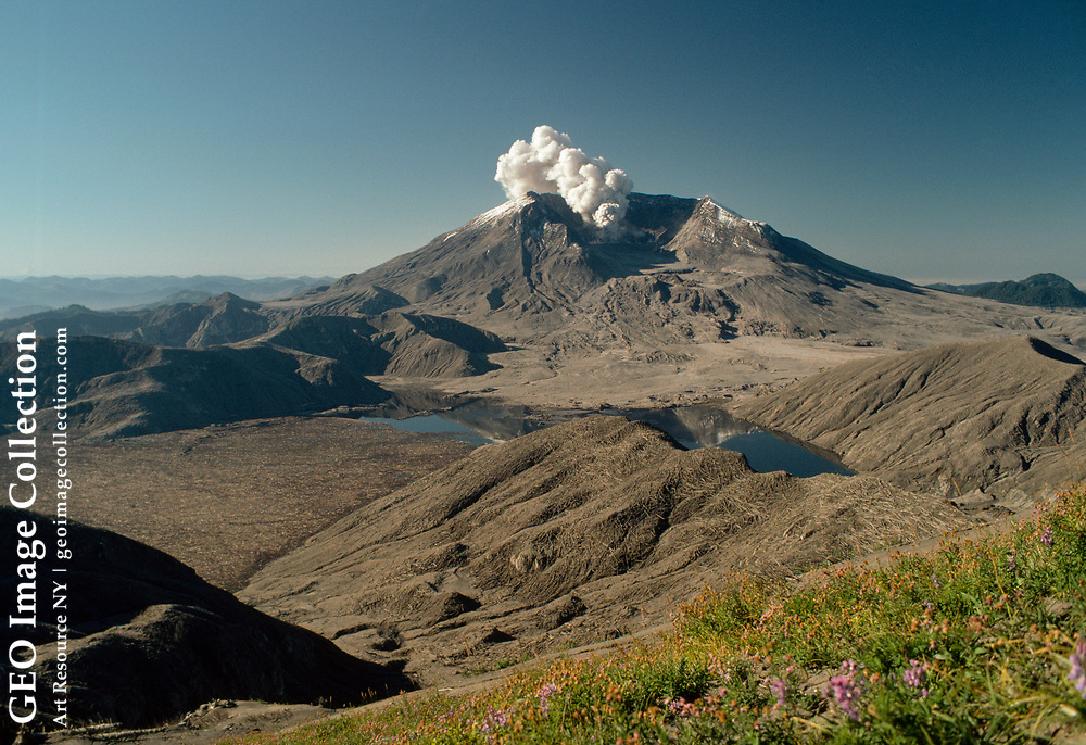 Steam rises from the truncated top of Mount St. Helens volcano.