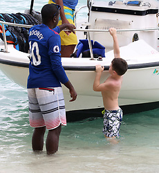 Kai Rooney is pictured enjoying a water toy ride with friends while on holiday in Barbados ***SPECIAL INSTRUCTIONS*** Please pixelate children's faces before publication.***. 24 Oct 2017 Pictured: Kai Rooney. Photo credit: QOTN/MEGA TheMegaAgency.com +1 888 505 6342