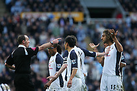 Photo: Andrew Unwin.<br />Newcastle United v Tottenham Hotspur. The Barclays Premiership. 01/04/2006.<br />Tottenham players surround the referee, Mike Dean (L), following the sending off of Michael Dawson.