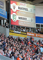 Blackpool fans sit in silence below the electronic scoreboard showing the score at Blackpool 1 - Norwich 3<br /> <br /> Photographer Rich Linley/CameraSport<br /> <br /> Football - The Football League Sky Bet Championship - Blackpool v Norwich City - Saturday 27th September 2014 - Bloomfield Road - Blackpool<br /> <br /> © CameraSport - 43 Linden Ave. Countesthorpe. Leicester. England. LE8 5PG - Tel: +44 (0) 116 277 4147 - admin@camerasport.com - www.camerasport.com
