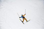 SHOT 3/15/16 11:45:31 AM - A skier jokingly lays on a run waiting for friends to come across him at Alta ski area. Alta is a ski area in the western United States, located in the town of Alta in the Wasatch Mountains of Utah, in Salt Lake County. With a skiable area of 2,200 acres, Alta's base elevation is 8,530 ft and rises to 10,550 ft for a vertical gain of 2,020 ft. One of the oldest ski resorts in the country, it opened its first lift in early 1939. Alta is known for being very high altitude and receives more snow than most Utah resorts, its average annual snowfall is 514 inches. Alta is one of three remaining ski resorts in America that prohibits snowboarders. (Photo by Marc Piscotty / © 2016)