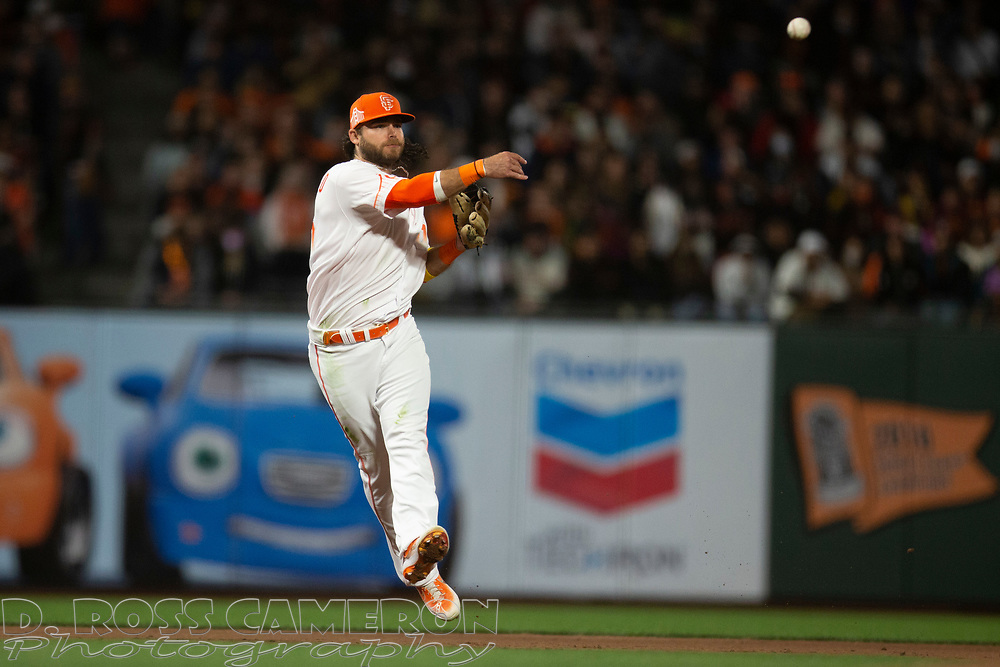 San Francisco Giants shortstop Brandon Crawford (35) leaves his feet to throw out Arizona Diamondbacks pinch hitter Henry Ramos during the fifth inning of a baseball game, Tuesday, Sept. 28, 2021, in San Francisco. (AP Photo/D. Ross Cameron)