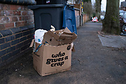Who gives a crap, enviromnetally friendly toilet roll company packaging left out on a street in Moseley on 11th January 2020 in Birmingham, United Kingdom. Various other pieces of recylable cardboard are stuffed inside awaiting collection.