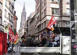 October 9, 2018 - Strasbourg, France - People seen playing musical instruments on the back of a truck with flags during the protest..People demonstrate during a one-day nationwide strike over French President Emmanuel Macron's policies in Strasbourg, eastern France. (Credit Image: © Elyxandro Cegarra/SOPA Images via ZUMA Wire)