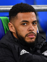 Watford's Andre Gray looks on in the dugout during the Premier League match at the Cardiff City Stadium.