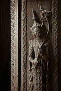A carving in a doorway at the Bagaya Monastery, the teak monastery, in the ancient city of Ava, Myanmar