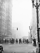 """Y-480121. """"Smog downtown"""" January 21, 1948. SW 6th at Alder looking south."""
