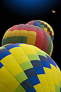 Vertical of three hot air balloons and moon<br />